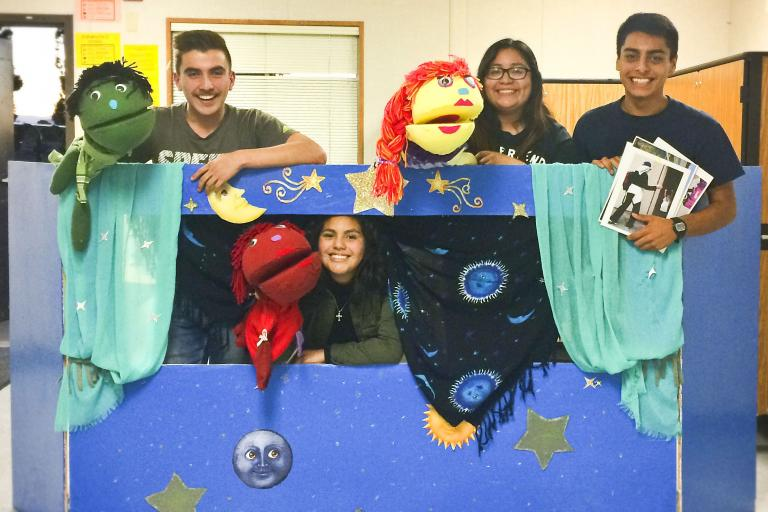 Youth Researcher Leading Educational Puppet Show