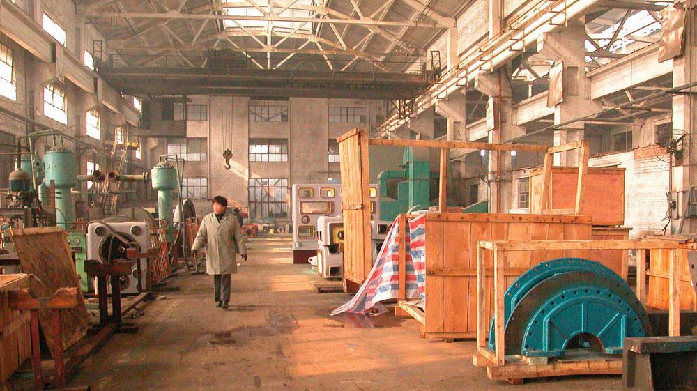 A Woman Walking Alone in an Air Separation Factory in China